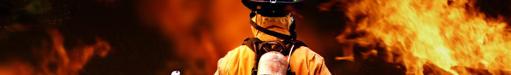 Fire Fighter walking into a burning house