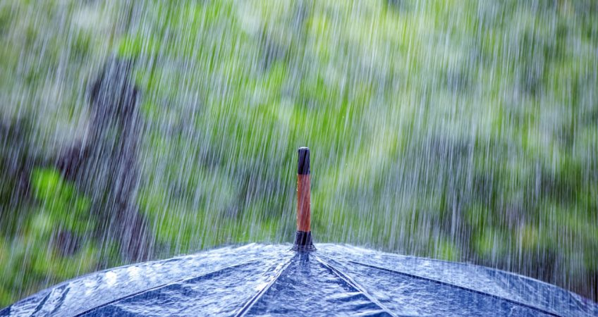 Rain hitting an umbrella